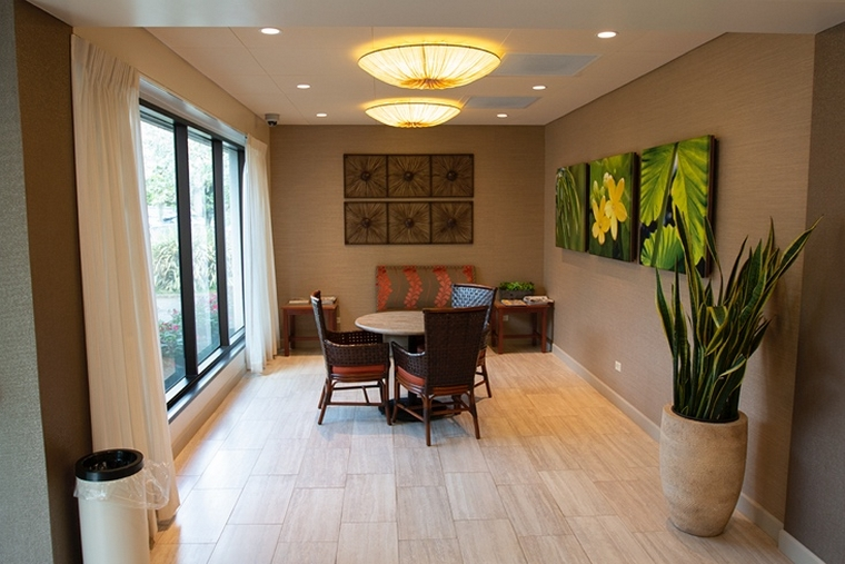 Our zen lobby provides our residents and their guests with the comforts of home, as they overlook the facility's lush landscaping.